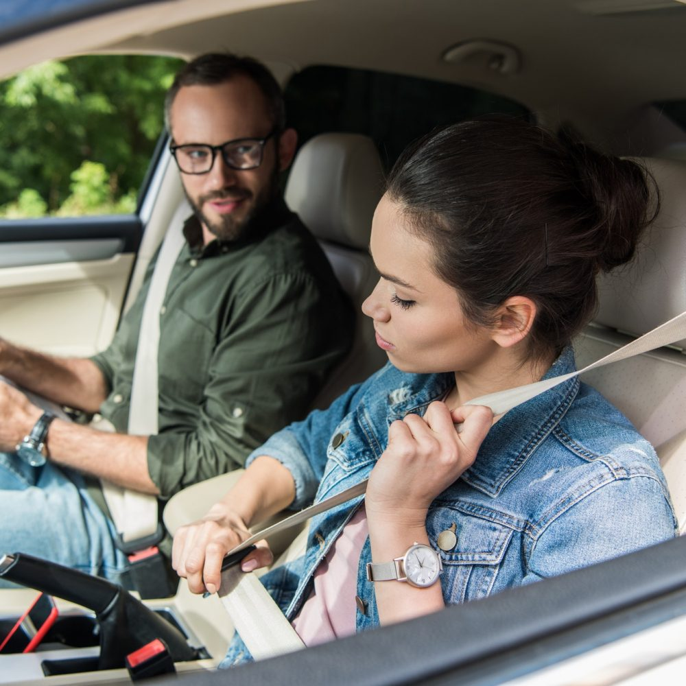 student-fastening-seat-belt-in-car-during-driving-test.jpg